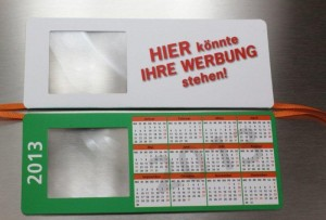 Lesezeichen mit Lupe und Kalender